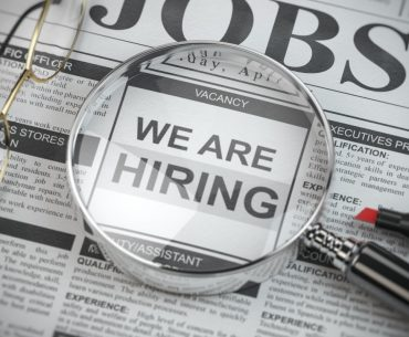 we are hiring job search and employment concept magnified glass with picture
